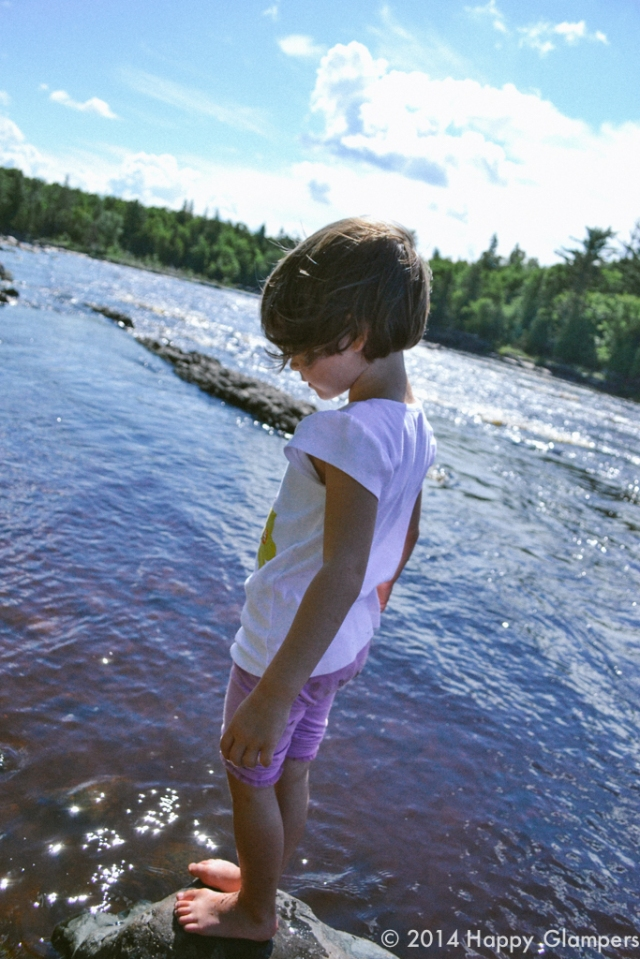 Child exploring the river at Jay Cooke State Park Duluth Minnesota